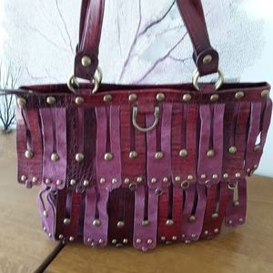 Women's zip-top leather and suede studded tote
